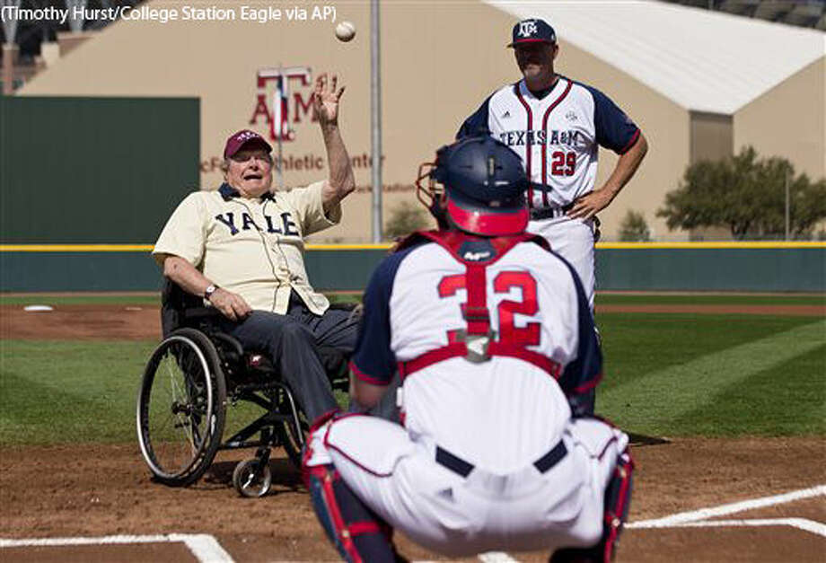 Former President George H. W. Bush throws out an opening pitch to Texas A&M player Stephen Kolek before a college baseball game between Texas A&M and Yale on Saturday, March 5, 2016, in College Station, Texas. (Timothy Hurst/College Station Eagle via AP) MANDATORY CREDIT Photo: Timothy Hurst