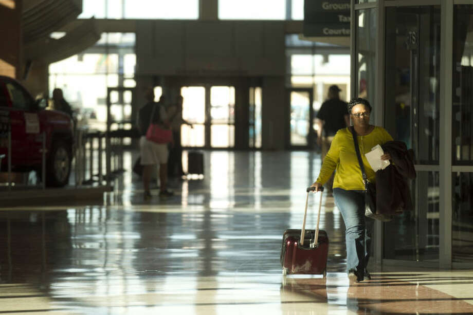 A traveler walks through the ticketing lobby of Midland International Airport, Feb. 13, 2014. James Durbin/Reporter-Telegram Photo: JAMES DURBIN