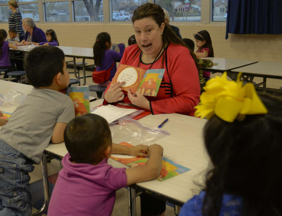 """Karmen Bryant was among volunteers with United Way and Women's Leadership Council who read to students at Crockett Elementary during the 2013-14 school year as part of the Ready to Read program. Crockett is one of nine Midland ISD campuses on Texas Education Agency's """"improvement required"""" list. Crockett is on for the sixth straight year."""
