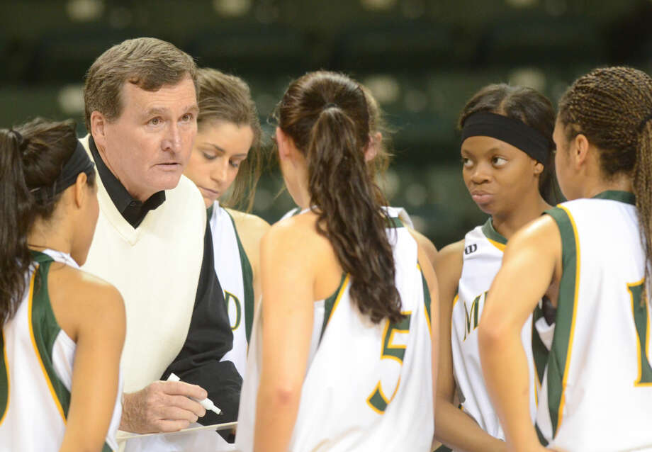 Midland College women's basketball head coach Ron Jones talks to his team during a time out in the game against Seward County College on Saturday, Nov. 14, 2015 at Chaparral Center. James Durbin/Reporter-Telegram Photo: James Durbin