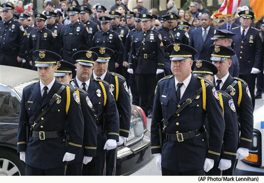 An honor guard with the Euless, Texas Police Department arrives for the funeral for colleague David Hofer, Monday, March 7, 2016, at St. Patrick's Cathedral in New York. Hofer was killed Tuesday, March 1 while responding to reports of shots fired in a park. Hofer was a 2008 graduate of New York University who served in the NYPD for five years before joining the Euless Police Department in 2014. (AP Photo/Mark Lennihan) Photo: Mark Lennihan