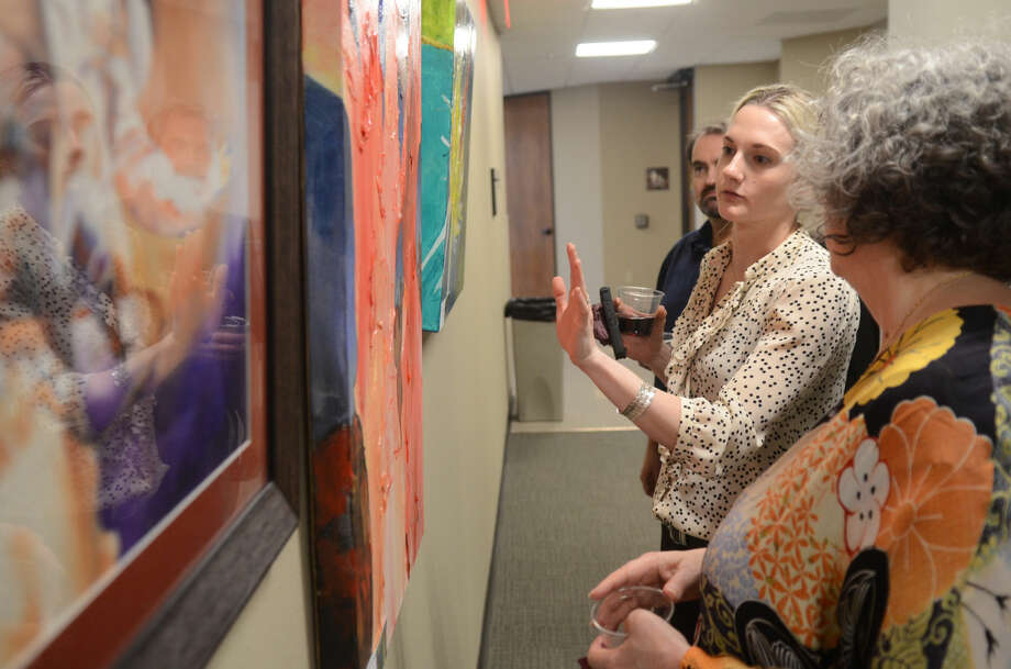 Reception to showcase local art from associations such as ArtiZen, Art Quest, Midland Arts Association and Midland Palette Club on display throughout the Midland Shared Spaces building, Thursday, March 19, 2015. James Durbin/Reporter-Telegram