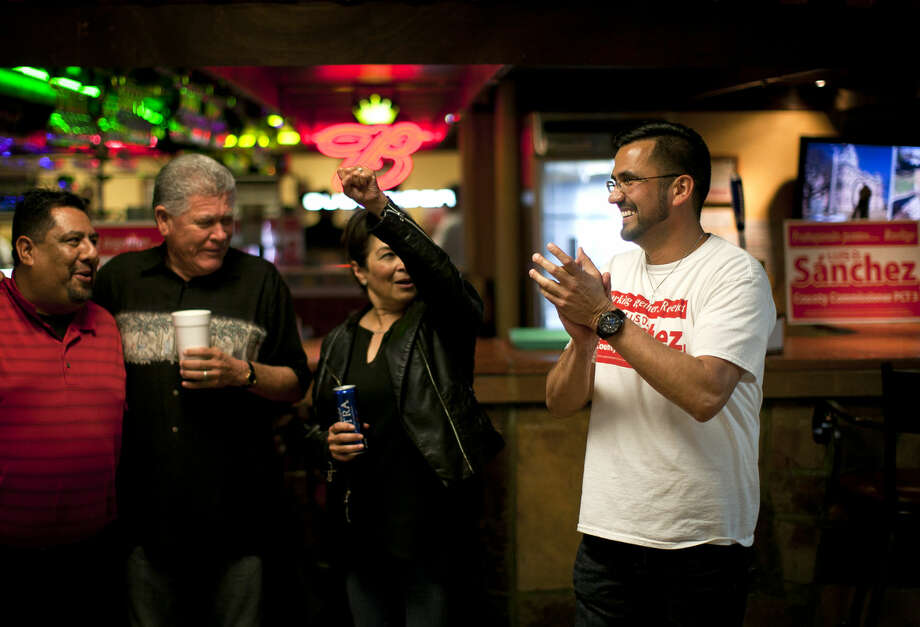 Luis Sanchez responds to results that he won his campaign for county commissioner of Precinct 3 during a watch party on Tuesday, March 1, 2016, at Martinez Bakery. James Durbin/Reporter-Telegram Photo: James Durbin