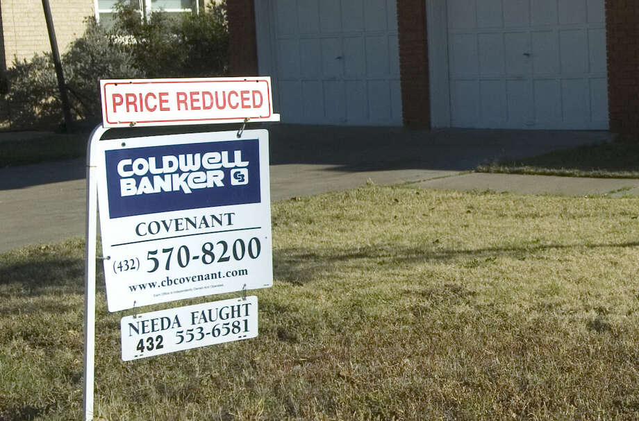 Home for sale in Midland with Price Reduced sign. Photo: File Photo
