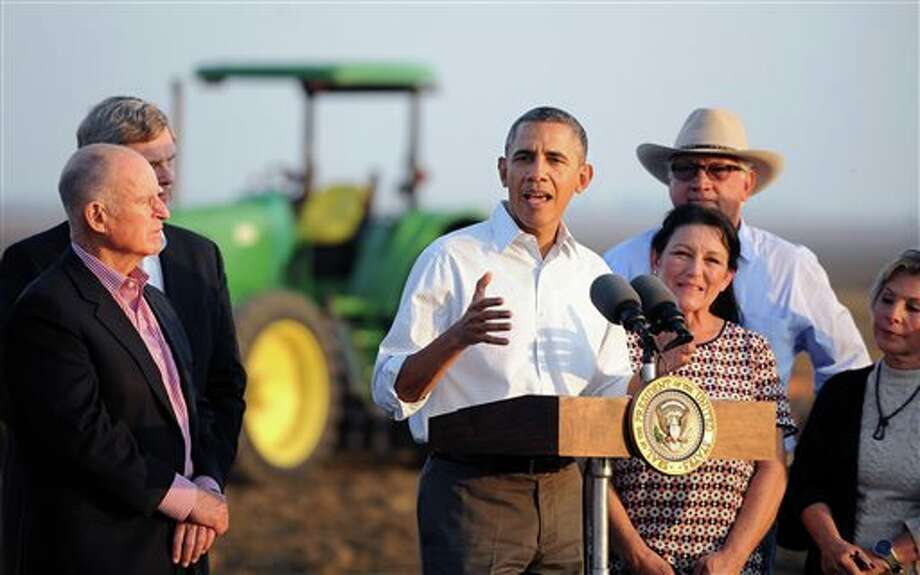 President Barack Obama speaks to the media, Friday, Feb. 14, 2014 in Los Banos, Calif. Farmers in California's drought-stricken Central Valley said the financial assistance President Barack Obama delivered on his visit Friday does not get to the heart of California's long-term water problems. (AP Photo/Los Angeles Times, Wally Skalij, Pool) Photo: Wally Skalij / Pool, Los Angeles Times