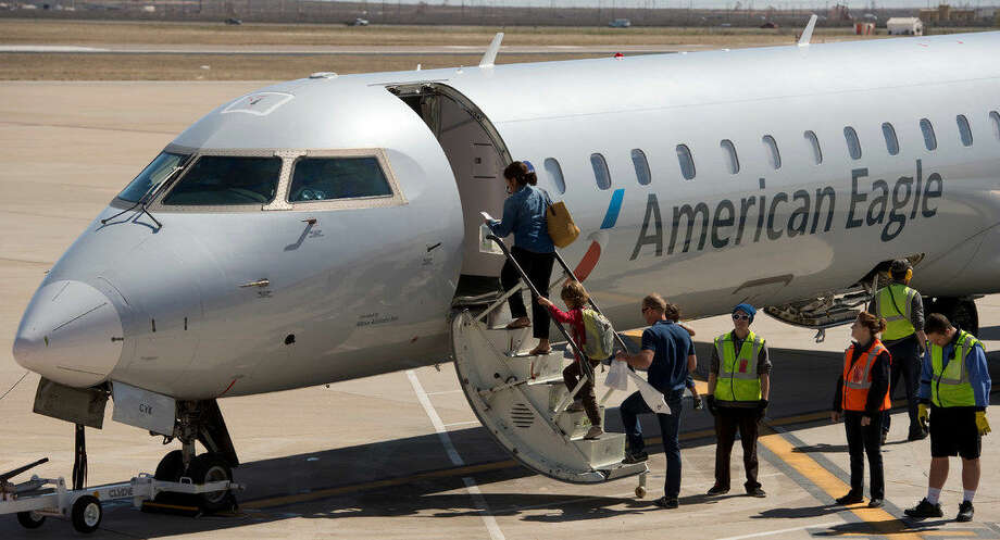 Passengers board the inaugural American Airlines direct flight from Midland to Phoenix Thursday 03-03-16 early afternoon. Tim Fischer\Reporter-Tel­egram Photo: Tim Fischer\Reporter-Tel­egram