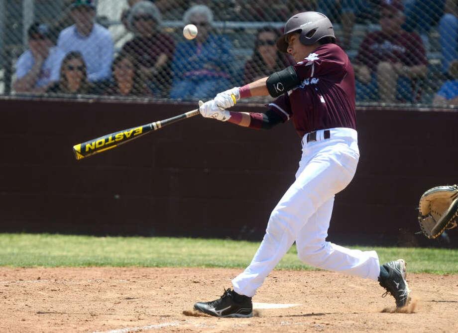 Lee's Evan Mata hits against Tascosa Saturday at Ernie Johnson Field. James Durbin/Reporter-Telegram Photo: JAMES DURBIN