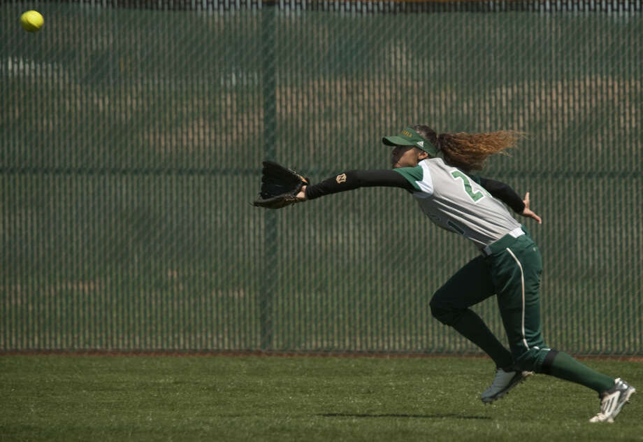 Midland College center fielder Danielle Bottley chases down a fly ball Friday, 3-27-15, in the first game of a doubleheader against Howard College. Tim Fischer\Reporter-Telegram Photo: Tim Fischer