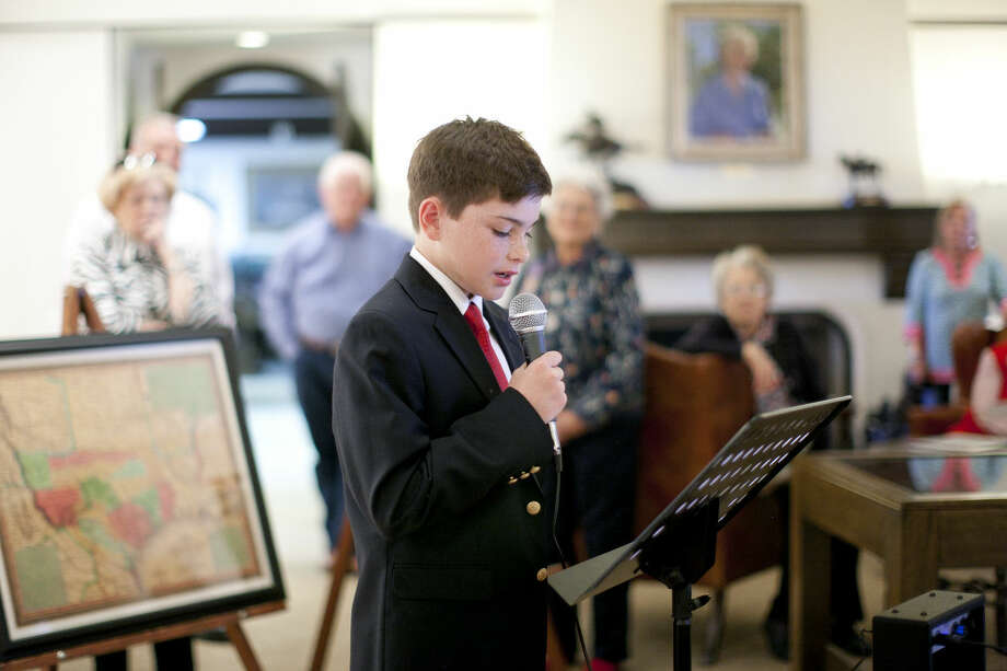 Daughters of the Republic of Texas essay contest winner Tanner Hedrick reads his essay during the Texas Independence Day celebration Wednesday, March 2, 2016, at the Haley Library. James Durbin/Reporter-Telegram Photo: James Durbin