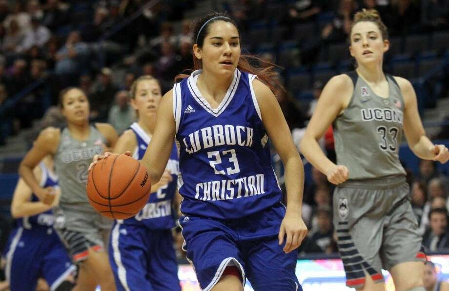 Lubbock Christian University senior guard Kelsey Hoppel is seen here with the ball in an exhibition game against UCONN in Hartford, Conn., on Nov. 2, 2015.  Photo courtesy of LCU Athletics. Photo: LCU Athletics