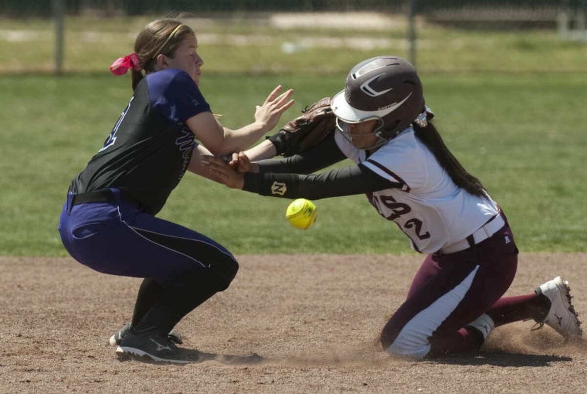 Lee High's Emily Nunez safely makes it to second as she bulls over Midland High's Aubree Rowley and knocks the ball away Saturday at Gene Smith Field. Tim Fischer\Reporter-Telegram