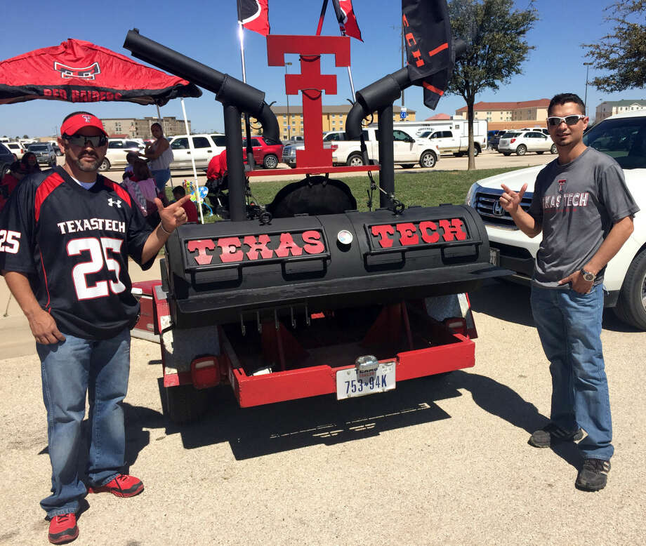 Odessans Cesar Bravo (left) and Carlos Marquez (right) pose with their Texas Tech-themed smoker at the tailgate festival during the Texas Tech spring game Saturday, March 28, 2015, at Grande Communications Stadium. Brandon Mulder/Reporter-Telegram Photo: James Durbin