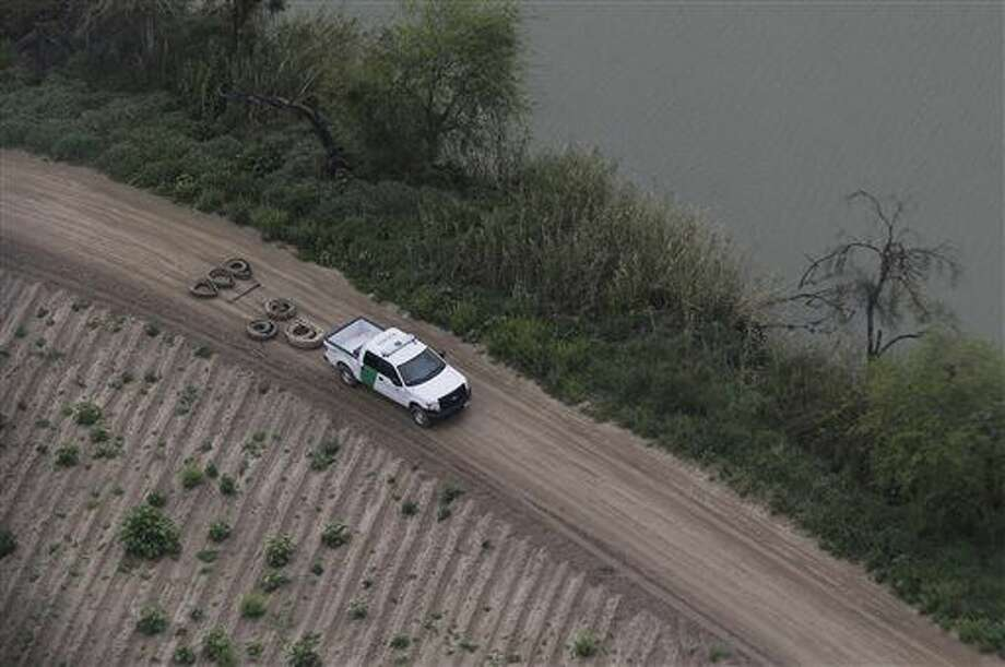 FILE - In this Feb. 24, 2015 file aerial photo, a U.S. Customs and Border Protection agent smooths a dirt road along the Rio Grande River on the Texas-Mexico border, near Rio Grande City, Texas. Drowning deaths have spiked since last fall as a surge of law enforcement along the Mexico border prompts immigrants, desperate to avoid detection by a surge of law enforcement, to choose more dangerous and remote crossings into South Texas. (AP Photo/Eric Gay, File) Photo: Eric Gay
