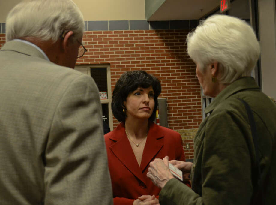 Christi Craddick, Texas Railroad Commissioner, talks with Bart and Sharla Hotchkiss in a file photo from a Bush Day Dinner. Tim Fischer\Reporter-Telegram Photo: Tim Fischer