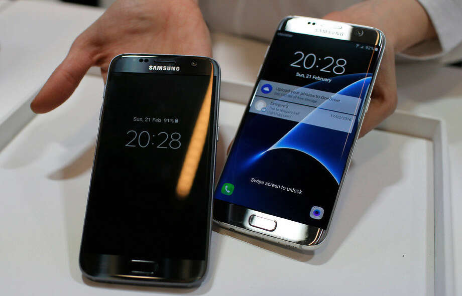 FILE - In this Sunday, Feb. 21, 2016, file photo, a SamsungGalaxyS7, left, andS7Edge are displayed during the SamsungGalaxyUnpacked 2016 event on the eve of the Mobile World Congress wireless show, in Barcelona, Spain. Samsung'sphone cameras have shown tremendous improvements in just a few years. The newGalaxyS7andS7Edge phones take better pictures than last year'sS6 models. They are neck and neck with Apple'siPhones, such that you no longer have to compromise on picture quality if you prefer Android. (AP Photo/Manu Fernadez, File) Photo: (AP Photo/Manu Fernadez, File)