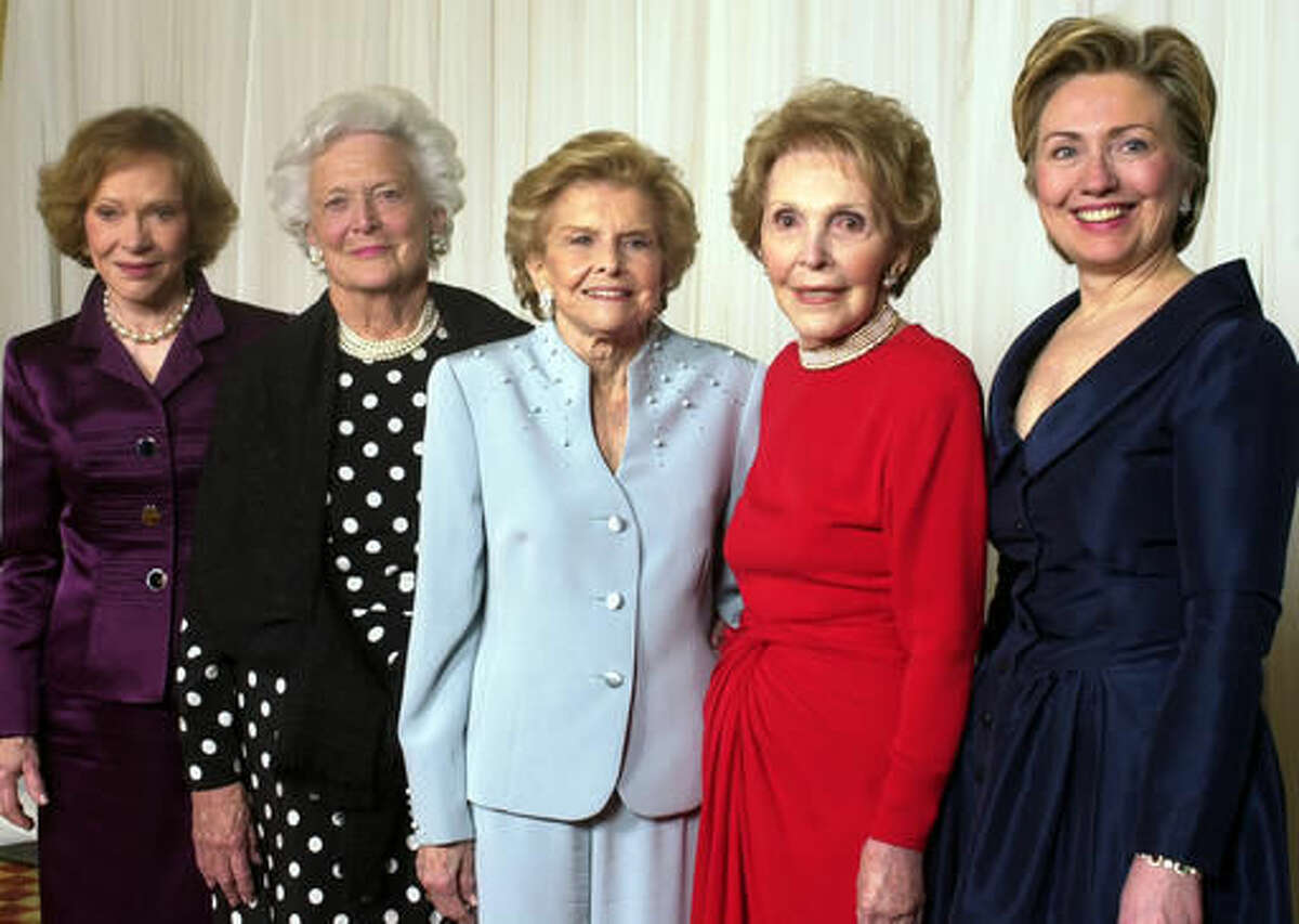 FILE - In this Jan. 17, 2003 file photo, former first ladies get together for a group photo at a gala 20th anniversary fundraising event saluting Betty Ford and the Betty Ford Center in Indian Wells, Calif. From left are Rosalynn Carter, Barbara Bush, Betty Ford, Nancy Reagan and Sen. Hillary Rodham Clinton. Former first lady Nancy Reagan, whose funeral service scheduled for Friday, March 11, 2016, was planned down to the smallest details by the former first lady herself. Scheduled to attend are former president George W. Bush and his wife Laura Bush, former first ladies Rosalynn Carter and Sen. Hillary Clinton, and first lady Michelle Obama. (AP Photo/Reed Saxon, File)