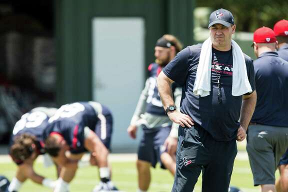 Houston Texans head coach Bill O'Brien watches his team warm up during rookie mini camp at The Methodist Training Center on Friday, May 6, 2016, in Houston.