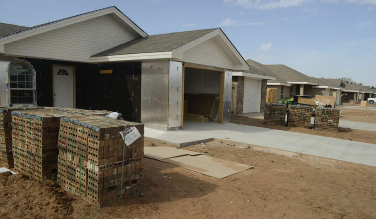 Affordable homes continue to be built to complete the block as part of Midland Community Development Corporations project on E. Jax. Tim Fischer\Reporter-Telegram
