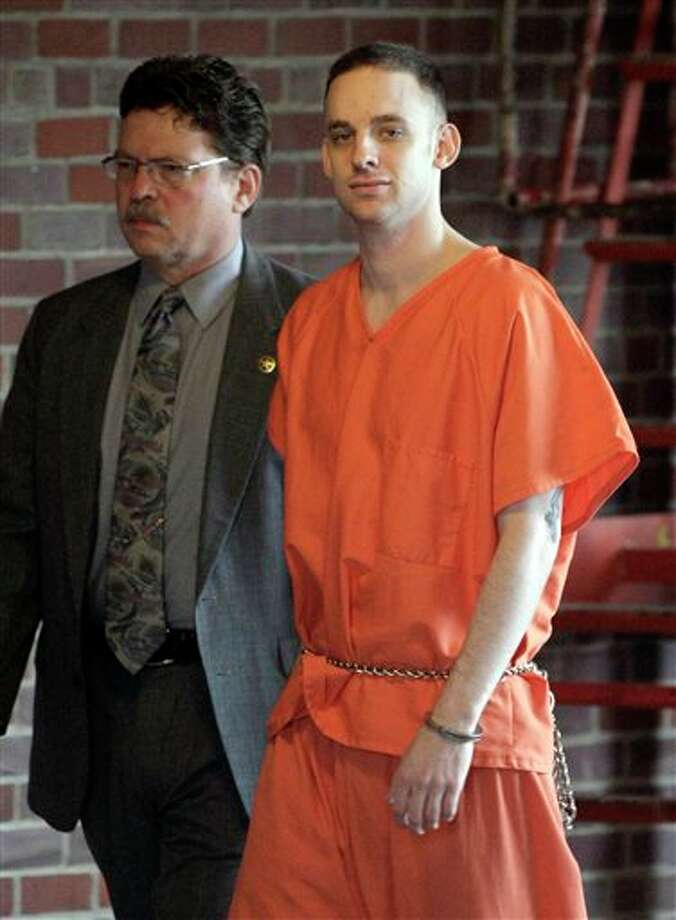 FILE - In this April 29, 2009 file photo, former 101st Airborne Division Pfc. Steven Dale Green is escorted to the courthouse on the third day of his trial in Paducah, Ky. Green, convicted of raping and killing a teenage Iraqi girl and using a shotgun to kill her family, died Saturday, Feb. 15, 2014 in prison in Arizona, likely of suicide. (AP Photo/Mark Humphrey, File) Photo: Mark Humphrey / AP