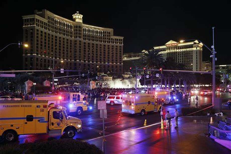 FILE - In this Dec. 20, 2015 file photo, police and emergency crews respond to the scene of a car accident along Las Vegas Boulevard in Las Vegas, after a woman drove her car into a crowd of tourists outside the Planet Hollywood and Paris casino-hotels. Pedestrian deaths surged by an estimated 10 percent last year as the economy improved, the price of gas plunged and motorists put more miles behind the wheel than ever before, according to an analysis of preliminary state traffic fatality data. (AP Photo/John Locher, File) Photo: John Locher