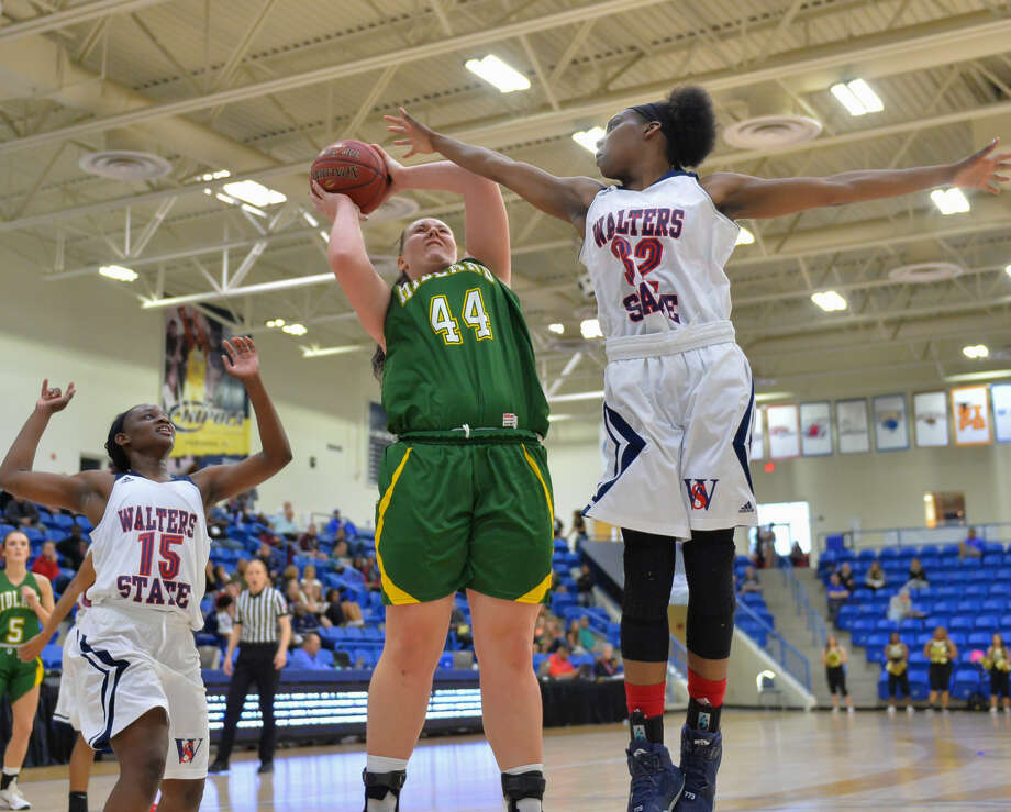 Lisa Kaempf (44), of the Midland College Lady Chaps, shoots the ball over Kendra Richardson (32) of the Walters State Lady Senators during the second round of the NJCAA Division I Women's Basketball Championships on March 15, 2016 at the Rip Griffin Center in Lubbock, Texas. (Photo by John Weast) Photo: John Weast