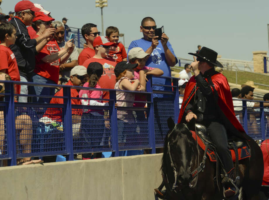 Texas Tech fans take pictures of the Masked Rider, March 29, 2014, during Texas Tech's scrimmage at Grande Communications Stadium. Tim Fischer\Reporter-Telegram Photo: Tim Fischer