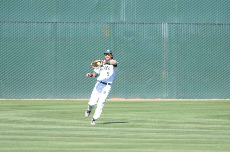 Midland College's Brent Stewart fields the ball against Western Texas College on Friday, March 27, 2015 at Christensen Stadium. James Durbin/Reporter-Telegram