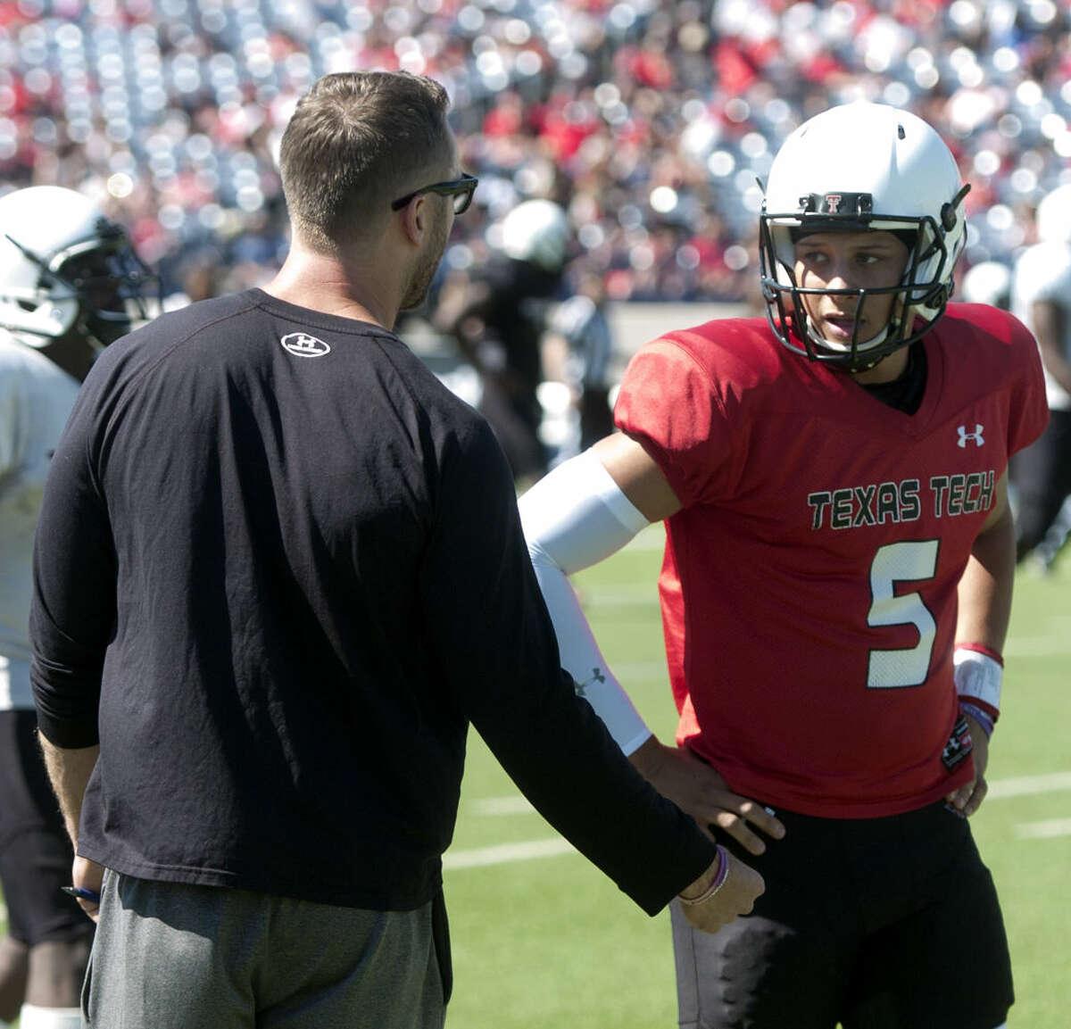 Texas Tech head coach Kliff Kingsbury talks with quarterback Patrick Mahomes (5) during the spring scrimmage on Saturday, March 28, 2015, at Grande Communications Stadium. James Durbin/Reporter-Telegram