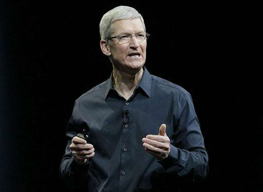 "FILE - In this June 2, 2014, file photo, Apple CEO Tim Cook speaks at the Apple Worldwide Developers Conference event in San Francisco. Cook says that so-called ""religious objection"" legislation being introduced in a number states like Indiana and Texas is dangerous. In an op-ed piece for The Washington Post, Cook said that the bills under consideration ""have the potential to undo decades of progress toward greater equality."" (AP Photo/Jeff Chiu, File) Photo: Jeff Chiu"