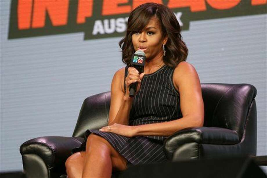 First lady Michelle Obama speaks at a panel discussion during South By Southwest at the Austin Convention Center on Wednesday, March 16, 2016, in Austin, Texas. (Photo by Rich Fury/Invision/AP) Photo: Rich Fury