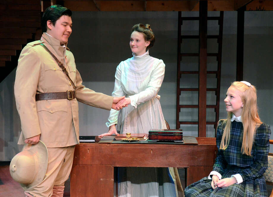 Miss Amelia (Lauren Smith) introduces herself to Captian Crewe (Jack Smith) and Sara (Sarah Brewer). Rehearsal for the upcoming production of MCT's Little Princess. James Durbin/Reporter-Telegram Photo: James Durbin