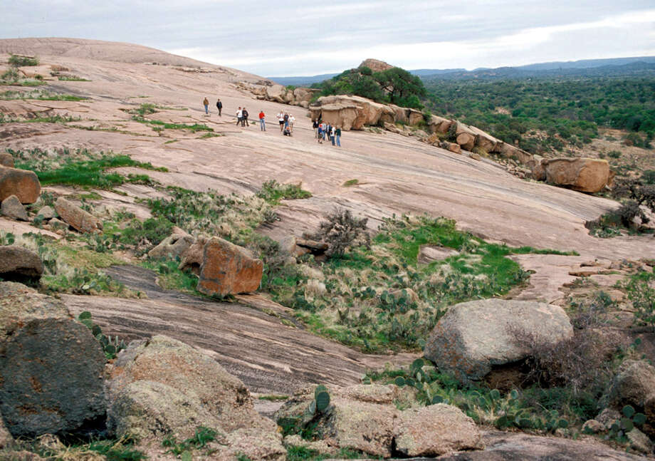 Enchanted RockEnchanted Rock State Natural Area covers 1,643 acres along Big Sandy Creek and lies between Fredericksburg and Llano. The 640-acre domed rock of pink granite rising 425 feet above the ground is the big draw. The natural area also features an abundance of wildlife, camping, climbing and hiking. You can read more about Painted Rock here. Keep clicking to see other nature spots in Texas worth the drive this summer.   Photo: EARL NOTTINGHAM, FREELANCER / SAN ANTONIO EXPRESS-NEWS