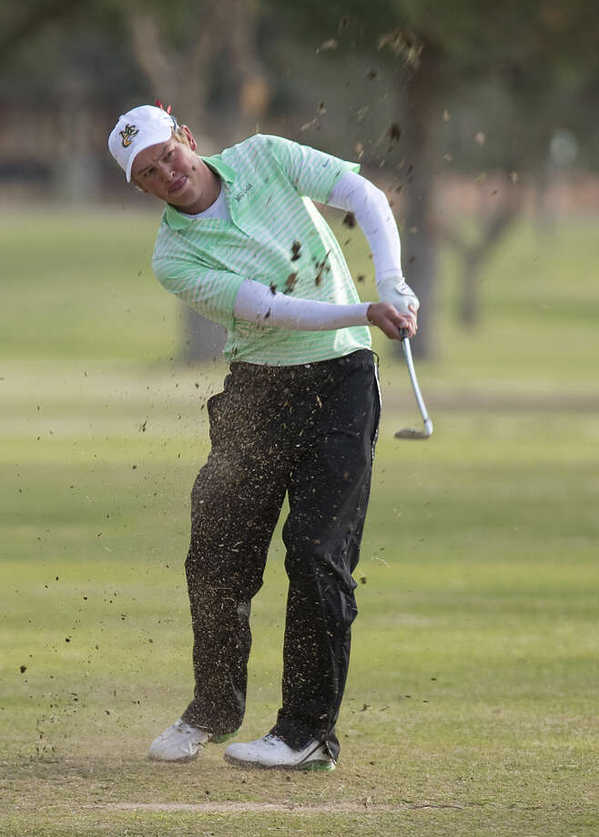 Midland College's Stefan Cronje chips toward the green Monday 03-14-16 at Green Tree Country Club during the first day of the Omega Treating Chemical Invitational. Tim Fischer\Reporter-Telegram