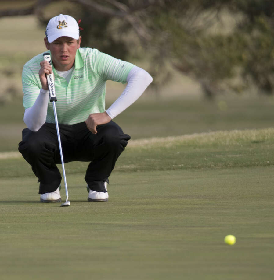 Midland College's Stefan Cronje checks his line before a putt Monday 03-14-16 at Greentree Country Club during the first day of the Omega Treating Chemical Invitaional. Tim Fischer\Reporter-Telegram