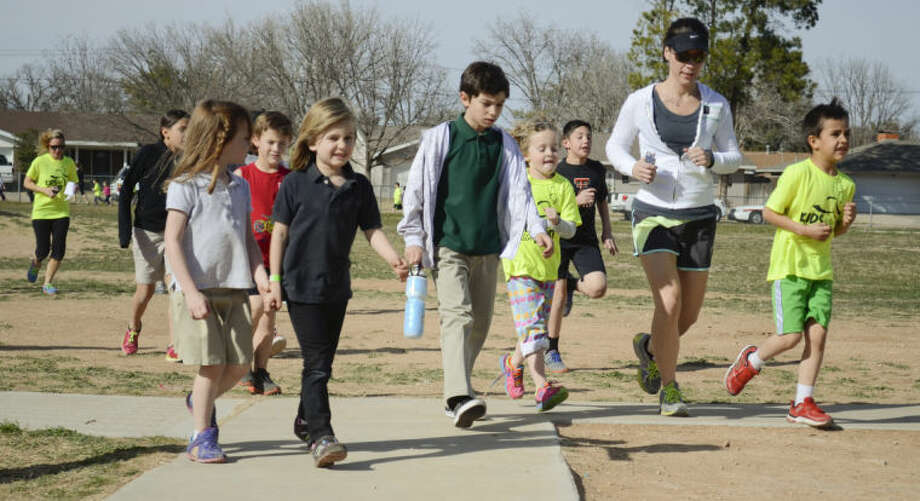 Fannin Elementary children run around the playground area as part of the running club at Fannin. Tim Fischer\Reporter-Telegram Photo: Tim Fischer