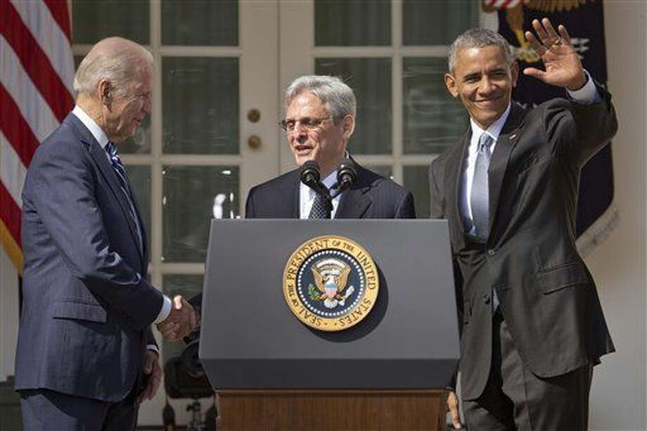 Federal appeals court judge Merrick Garland, center, stands with President Barack Obama and Vice President Joe Biden after being introduced as Obama's nominee for the Supreme Court during an announcement in the Rose Garden of the White House, in Washington, Wednesday, March 16, 2016. Garland, 63, is the chief judge for the United States Court of Appeals for the District of Columbia Circuit, a court whose influence over federal policy and national security matters has made it a proving ground for potential Supreme Court justices. (AP Photo/Pablo Martinez Monsivais) Photo: Pablo Martinez Monsivais