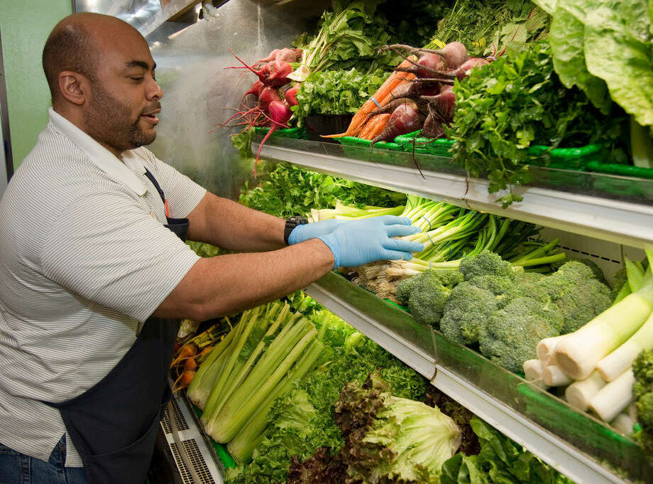 Natural Grocers manager Larry Parker checks the all organic produce Thursday 03-10-16 at the store. Parker startedMidlandStrong, a series of fundraisers to benefit local non-profits in the community. Tim Fischer\Reporter-Telegram Photo: Tim Fischer\Reporter-Telegram