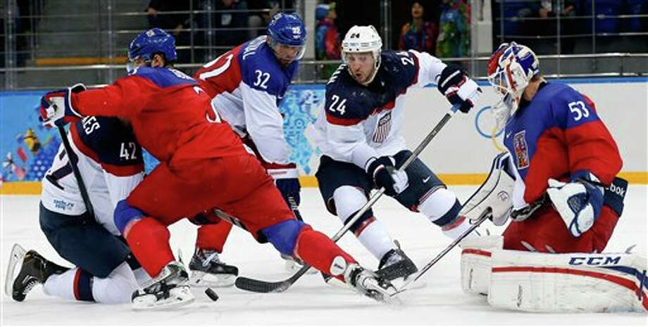 USA forward David Backes (42) and USA forward Ryan Callahan (24) try to gain control of the puck in front of the the Czech Republic goal as Czech Republic defenseman Radko Gudas (3), Czech Republic defenseman Michal Rozsival (32) and Czech Republic goaltender Alexander Salak defend during the second period of men's quarterfinal hockey game in Shayba Arena at the 2014 Winter Olympics, Wednesday, Feb. 19, 2014, in Sochi, Russia. (AP Photo/Petr David Josek) Photo: Petr David Josek / AP