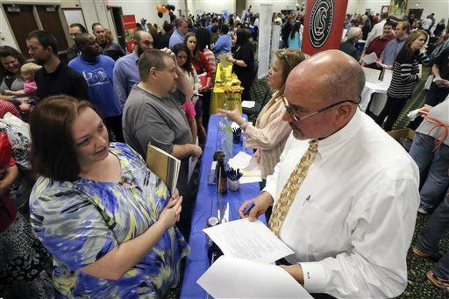 Frances Scoggins, left, speaks to Michael McCall, general manager for Chattanooga Labeling Systems, about her resume during a huge 15-county North Georgia job fair at The Colonnade in Ringgold, Ga., on Thursday, April 2, 2015. Scoggins has been unemployed for the past 4-months and is looking for a safety or manufacturing job. The U.S. government issues the March jobs report on Friday, April 3, 2015. (AP Photo/Chattanooga Times Free Press, Dan Henry) Photo: Dan Henry