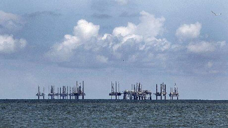 Semi-subermisible oil rigs and jackup shallow-waterdrillingunits stand idle in the Gulf of Mexico off the coast of Cameron, Louisiana, U.S., on Saturday, July 17, 2010.Aaron M. Sprecher/Bloomberg Photo: Bloomberg