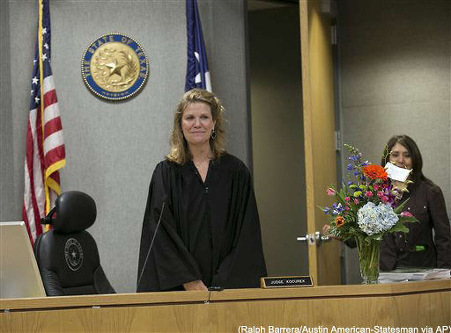 District Judge Julie Kocurek, here making her first public appearance, was welcomed back to the bench Monday, Feb. 29, 2016, in Austin, Texas, after spending weeks recovering from an assassination attempt in November of last year. She said she felt reborn and though she is still undergoing physical therapy for her wounds will spend only half days on the bench for now. (Ralph Barrera/Austin American-Statesman via AP)