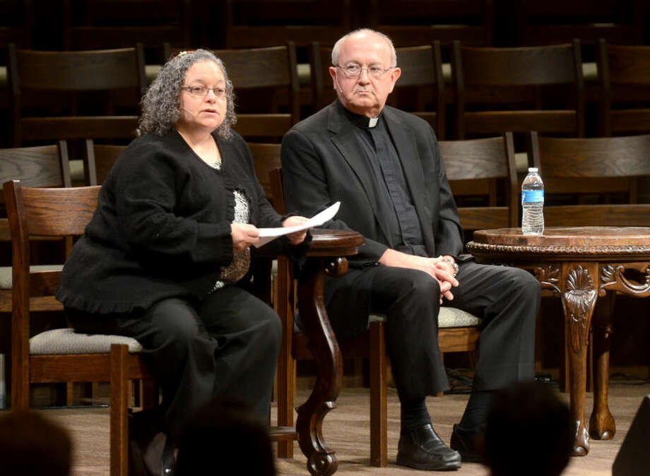 From left, Rabbi Holly Cohn of Temple Beth El in Odessa and Monsignor Larry Droll of St. Ann's Catholic Church take turns answering questions with other religious leaders during the fourth annual Interfaith Event in Midland. James Durbin/Reporter-Telegram Photo: JAMES DURBIN