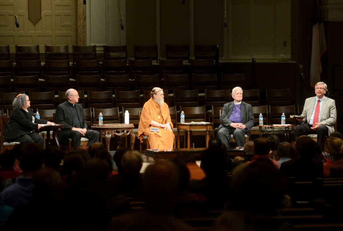 From left, Rabbi Holly Cohn of Temple Beth El in Odessa, Monsignor Larry Droll of St. Ann's Catholic Church, Satguru Bodhinatha Veylanswami of Kauai's Hindu Monastery in Hawaii, Retired Bishop Sam Hulsey of Episcopal Diocese of Northwest Texas and Rev. Randel Everett of First Baptist Church take turns answering questions during 2014's Interfaith Event in Midland. James Durbin/Reporter-Telegram