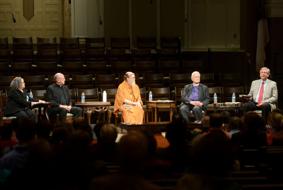 From left, Rabbi Holly Cohn of Temple Beth El in Odessa, Monsignor Larry Droll of St. Ann's Catholic Church, Satguru Bodhinatha Veylanswami of Kauai's Hindu Monastery in Hawaii, Retired Bishop Sam Hulsey of Episcopal Diocese of Northwest Texas and Rev. Randel Everett of First Baptist Church take turns answering questions during 2014's Interfaith Event in Midland. James Durbin/Reporter-Telegram Photo: JAMES DURBIN