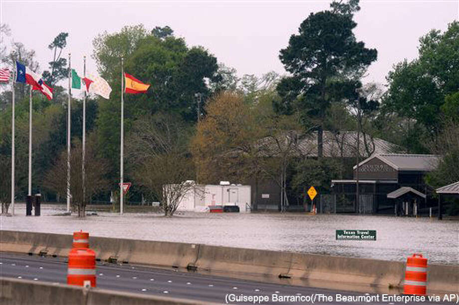 Floodwaters build up along Interstate 10 near exit 880 near Orange, Texas, Tuesday, March 15, 2016. Travelers on parts of Interstate 10 in Southeast Texas face detours due to flooding of the nearby Sabine River following recent heavy rains. (Guiseppe Barranco(/The Beaumont Enterprise via AP)