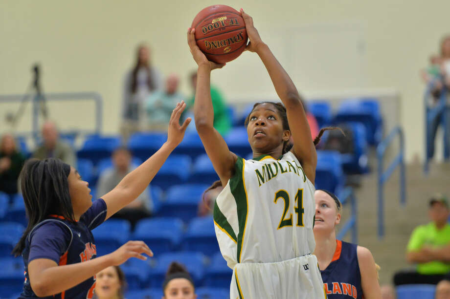 LUBBOCK, TX - MARCH 14: Walnatia Wright (24) of the Midland College Lady Chaps drives to the basket during the first round of the NJCAA Division I Women's Basketball Championships against the Highland Community College Cougars on March 14, 2016 at the Rip Griffin Center in Lubbock, Texas. (Photo by John Weast) Photo: John Weast