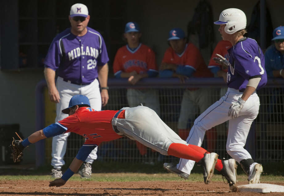 Midland High's Ethan Barker make it safely to first as San Angelo Cedntral's Jd Aguilar dives off the bag for the ball Thursday, 4-2-15 at Zachery Field. Tim Fischer\Reporter-Telegram Photo: Tim Fischer
