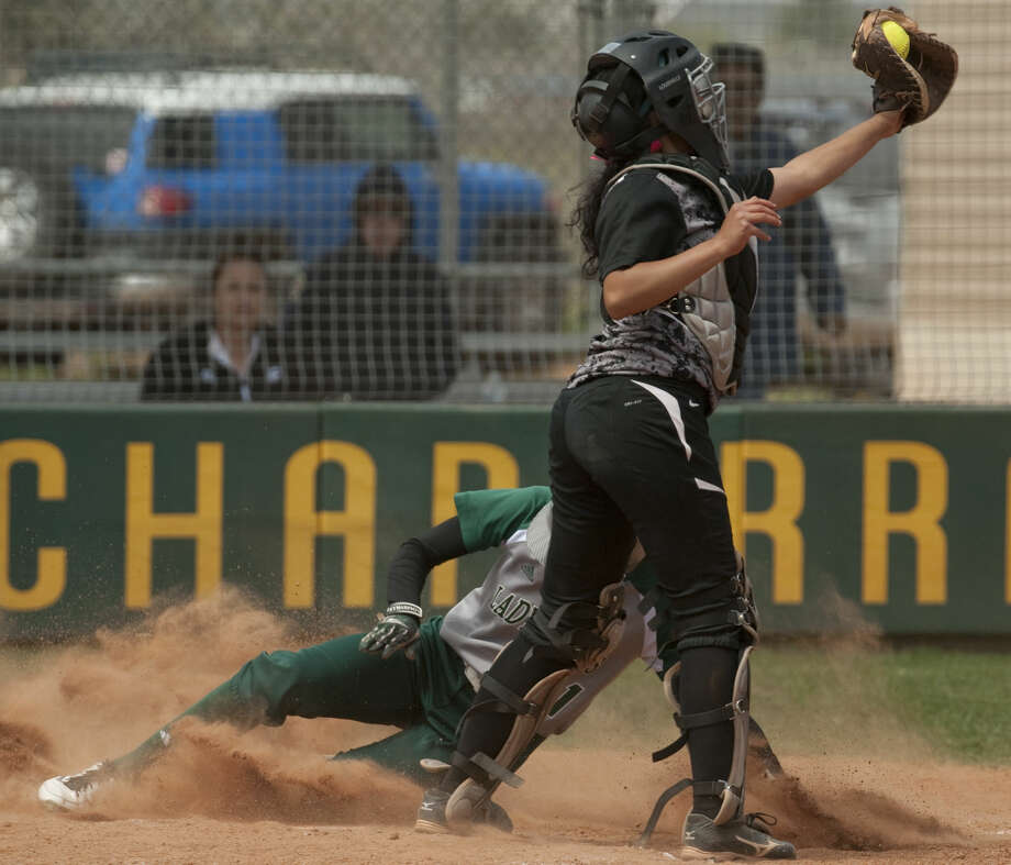 Midland College's Danielle Bottley safely slides into home for a run as Luna College's Mercedes Gonzalez reaches for the ball Friday, 4-3-15, at MC. Tim Fischer\Reporter-Telegram Photo: Tim Fischer