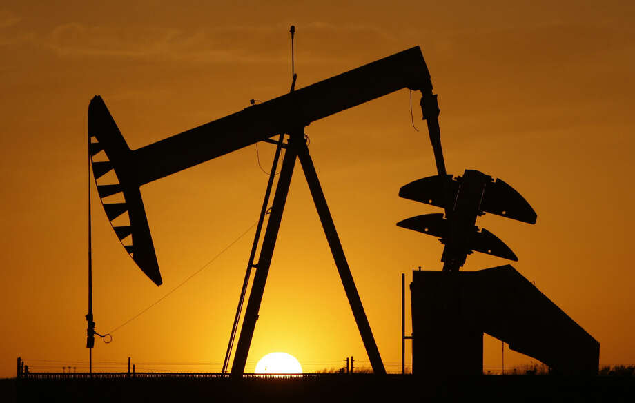 FILE - In this March 22, 2012 file photo, a pumpjack is silhouetted against the setting sun in Oklahoma City.(AP Photo/Sue Ogrocki, File) Photo: Sue Ogrocki