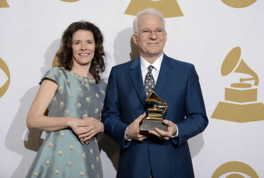 "Edie Brickell, left, and Steve Martin pose in the press room with the award for best American roots song, ""Love Has Come For You,"" at the 56th annual Grammy Awards at Staples Center on Sunday, Jan. 26, 2014, in Los Angeles. (Photo by Dan Steinberg/Invision/AP) Photo: Dan Steinberg"